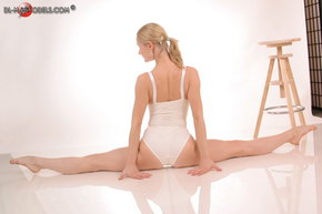nude ballerina and chair